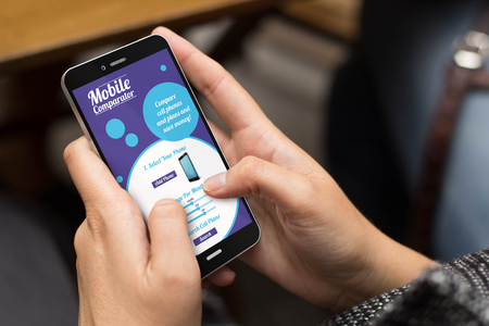 connectivity concept: girl using a digital generated phone with mobile comparator on the screen. All screen graphics are made up.
