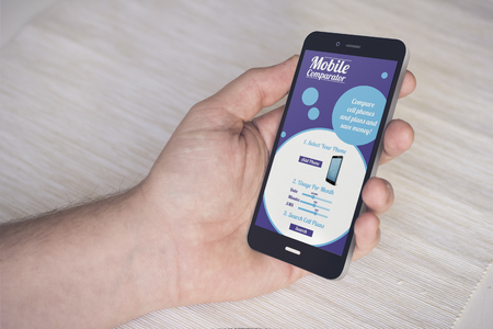 hand with digital generated smartphone with online mobile comparator interface. Screen graphics are made up.