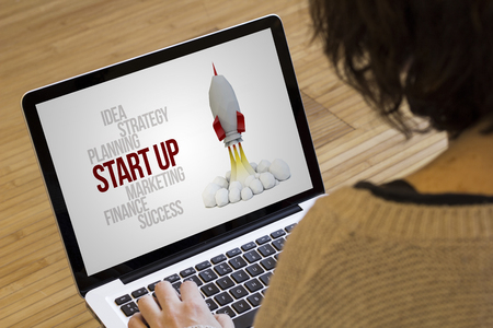 marketing and business concept: start up on a laptop screen. Screen graphics are made up. Zdjęcie Seryjne