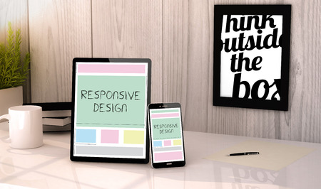 interface design: Digital generated tablet and phone on a desktop workplace with responsive design on screen. Stock Photo