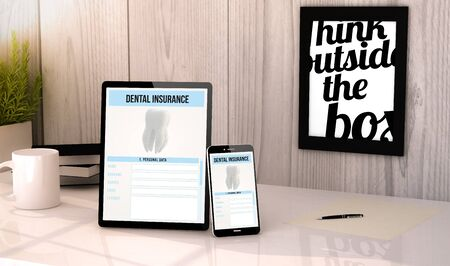 dental health: Digital generated tablet and phone on a desktop workplace dental insurance on screen. Stock Photo