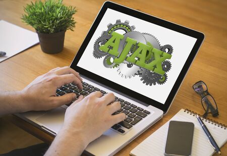 ajax: Developer or web designer at work. Close-up top view of man working on laptop with ajax on screen. Stock Photo
