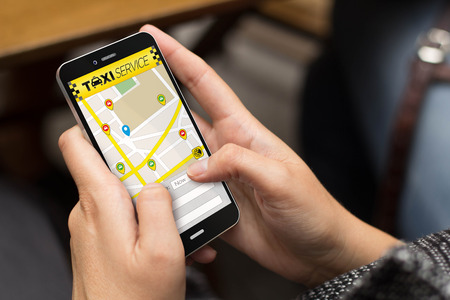taxi cab: business concept: girl using a digital generated phone with taxi app.