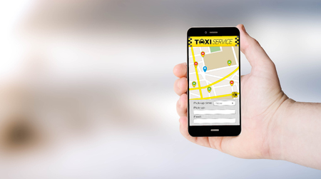mobile apps: mobile phone with taxi app on digital generated phone screen with sea background