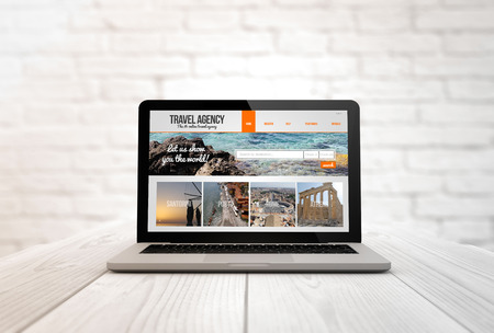 briks: tourism concept: digitally generated laptop on a wooden table with travel agency. Screen graphics are made up.