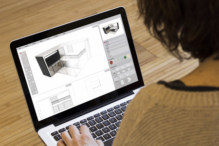 architecture concept: house modelling on a laptop screen.