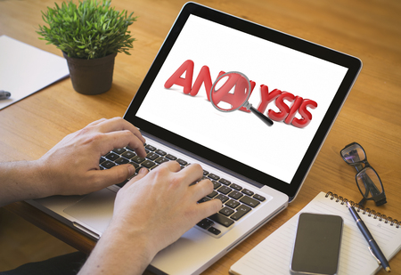 analisys: Analisys. Close-up top view of man working on laptop. all screen graphics are made up.