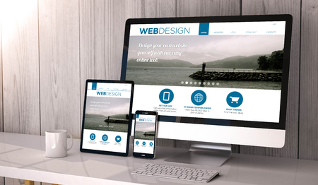 web screen: Digital generated devices on desktop, responsive blank mock-up with web design fluid template website  on screen. All screen graphics are made up. Stock Photo