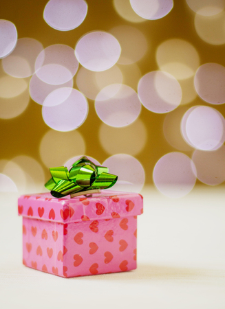 red rose bokeh: valentines gift box with bokeh background