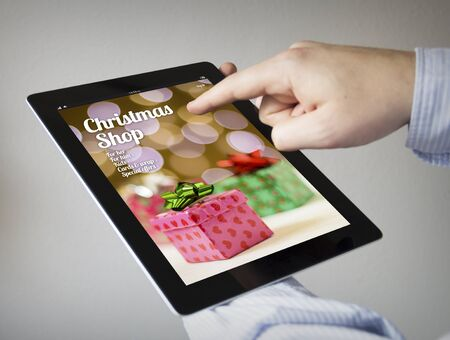 sellout: new technologies concept: hands with touchscreen tablet with online shopon the screen. Screen graphics are made up.