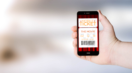 movie film: mobile cinema ticketson digital generated phone screen with sea background. All screen graphics are made up.