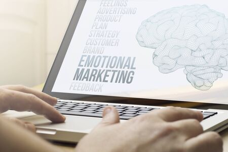 marketing concept: modern marketing concept concept: man using a laptop with emotional marketing on the screen. Screen graphics are made up.