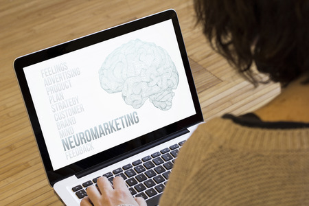 influential: marketing concept: neuromarketing on a laptop screen. Screen graphics are made up.