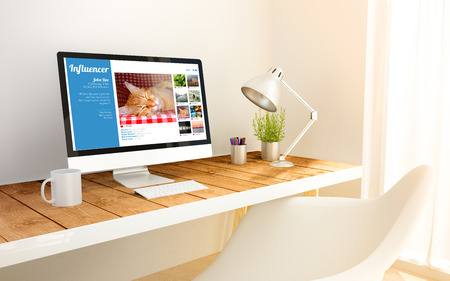 influencer: 3d generated minimalist workspace with influencer profile on screen computer and copyspace. 3d illustration. all screen graphics are made up. Stock Photo