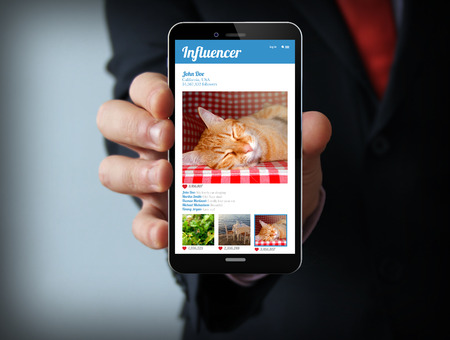 influencer: businessman with 3d generated smartphone with influencer profile on the screen