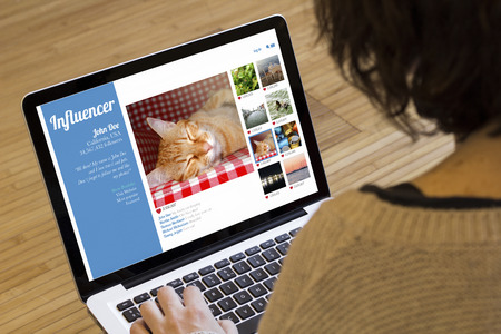 marketing influencer concept: influencer website on a laptop screen. Screen graphics are made up. Stock Photo