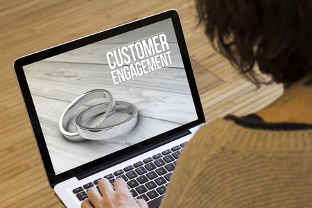 strategic advantage: marketing online concept: customer engagement on a laptop screen. Screen graphics are made up.