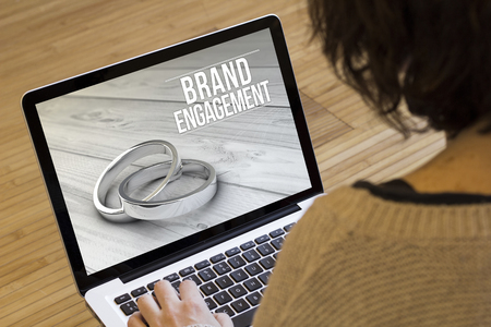 strategic advantage: marketing online concept: brand engagement on a laptop screen. Screen graphics are made up. Stock Photo