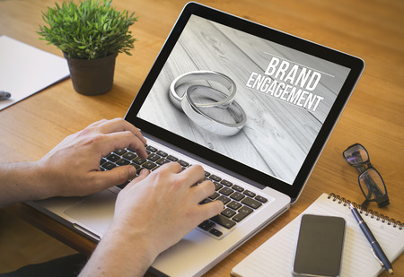 strategic advantage: online marketing brand engagement concept. Close-up top view of a businessman working on laptop. all screen graphics are made up. Stock Photo