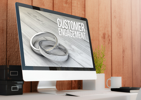 strategic advantage: modern wooden workspace with computer showing customer engagement. All screen graphics are made up. 3D illustration. Stock Photo