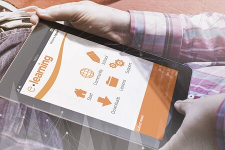 all: close-up view of man holding a tablet showing elearning online site. E-learning concept. All screen graphics are made up.