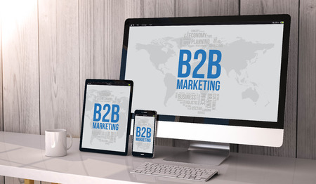 marketing concept: Digital generated devices on desktop, responsive with b2b marketing concept  on screen. All screen graphics are made up.