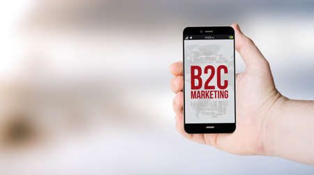 b2c: mobile phone with b2c marketing on digital generated phone screen with sea background. All screen graphics are made up.