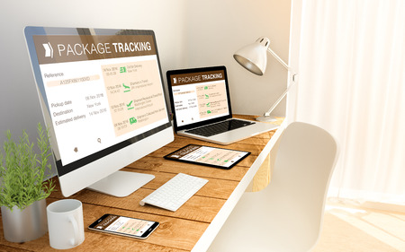 Digital generated devices over a wooden table with package tracking responsive website. All screen graphics are made up. Stockfoto