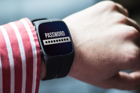 wristlet: lifestyle concept: password on watch. Screen graphics are made up. Stock Photo