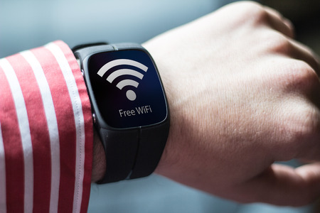 wristlet: lifestyle concept: free wifi on watch. Screen graphics are made up. Stock Photo