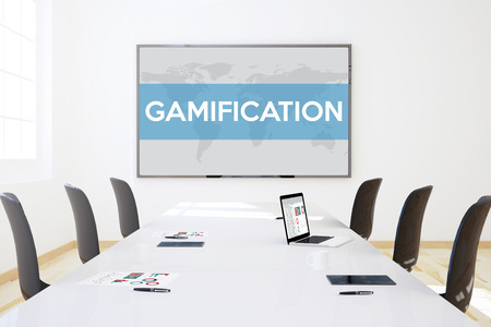 big screen: 3d rendering of business meeting room with big screen showing gamification concept
