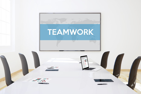 big screen: 3d rendering of business meeting room with big screen showing teamworkconcept Stock Photo