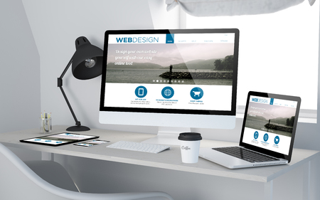 3d rendering of workroom with responsive devices showing web design on screen. All screen graphics are made up.