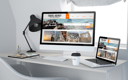 3d rendering of workroom with responsive devices showing  travel agency on screen. All screen graphics are made up.