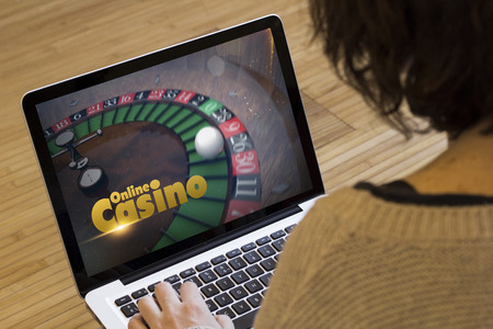 gaming online concept: online casino on a laptop screen. Screen graphics are made up.