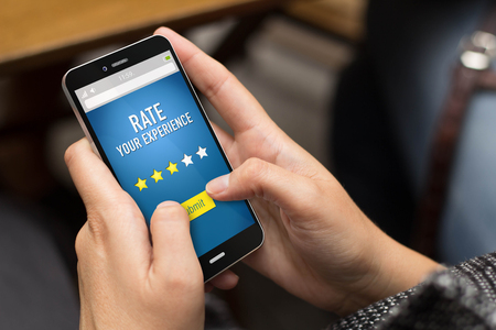 restaurant rating: Technology concept: girl using a digital generated phone to rate a experience.