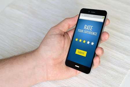 restaurant rating: Close up of hand using a smart phone to pointing with stars experience. 3D generated.