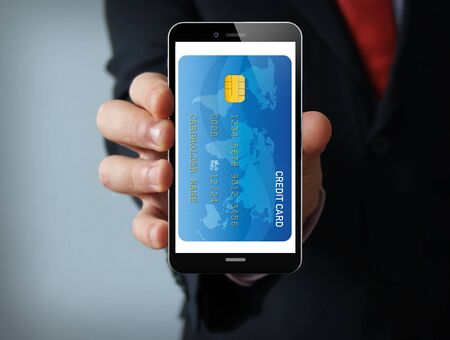 touch phone: digital business concept: businessman hand holding a touch phone with digital credit card on the screen.