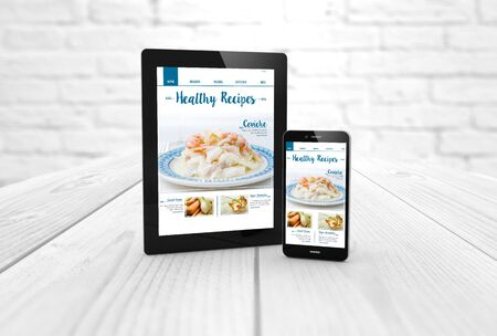 digital generated tablet and smartphone with healthy recipes blog on screen. 3d rendering.