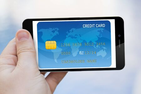 smart card: Mobile commerce concept: hand holding smart phone with credit card screen isolated.