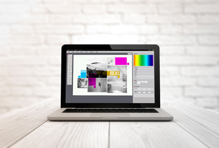 briks: creativity concept: digitally generated laptop on a wooden table with graphic design software.