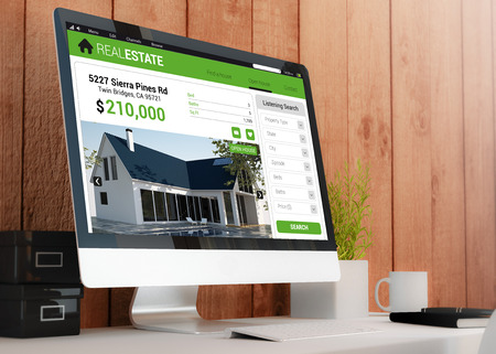 website words: modern wooden workspace with real estate website on the computer. 3D illustration. Stock Photo