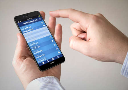 business credit application: Close up of man using 3d generated mobile smart phone with mobile banking app on the screen.