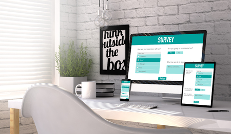stilish: Business concept: Devices generated with survey responsive web on the screen on stilish workplace. All graphics are made up. Stock Photo