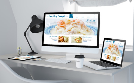 3d rendering of workroom with responsive devices showing healthy recipes on screen. Stock Photo