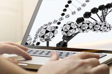 geneticist: online business concept: man using a laptop with online marketing on the screen. Stock Photo