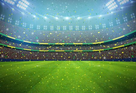 Soccer stadium in the night with yellow and green colours team. Stock Photo