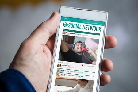 influencer: man hand holding social network smartphone.