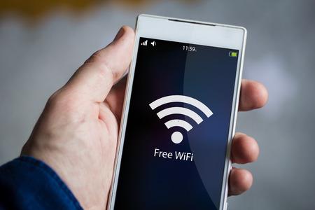 wifi: man hand holding free wifi smartphone.