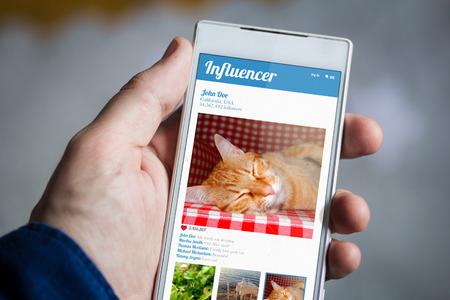 influencer: man hand holding influencer smartphone.